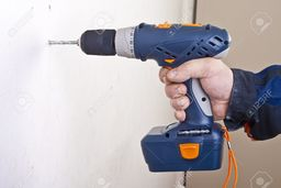 Thumb 9284695 a man drilling a hole in the wall  stock photo
