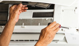 Thumb air conditioning contractor repairing filter