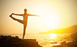 Thumb woman doing yoga beach sunset sea 38656093